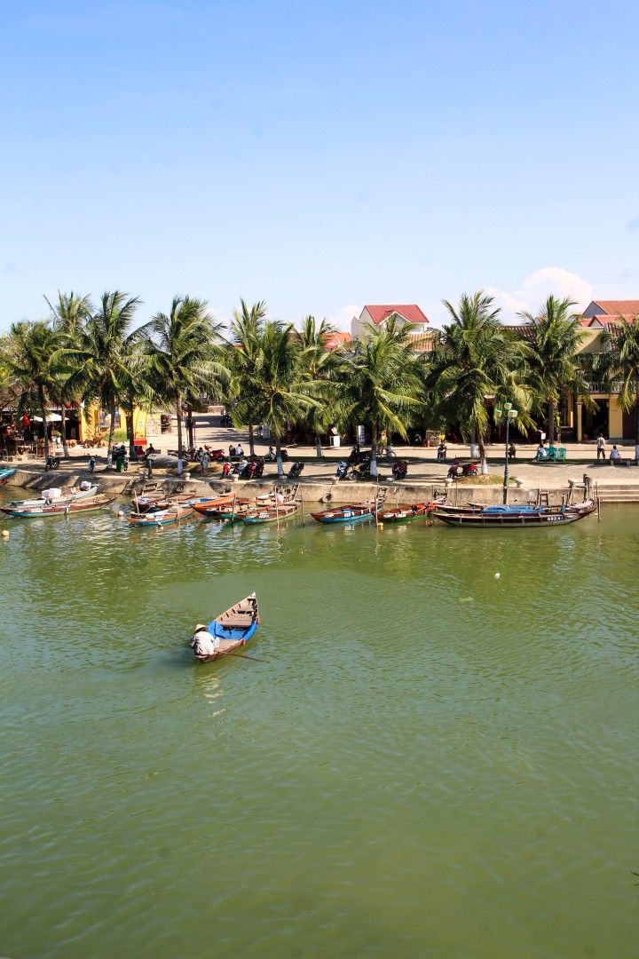 Boat making its way across the river, Hoi An, Vietnam
