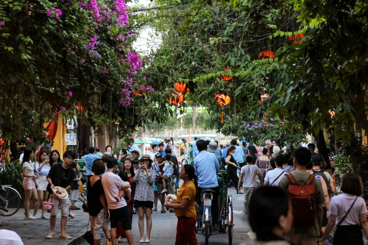 Lanterns and tourists in Hoi An, Vietnam