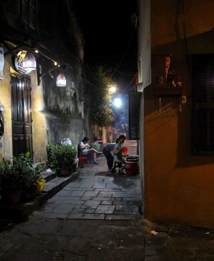 People cooking dinner in the street, Hoi An, Vietnam