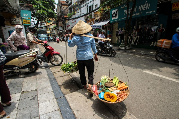 Woman carrying food in Hanoi, Vietnam