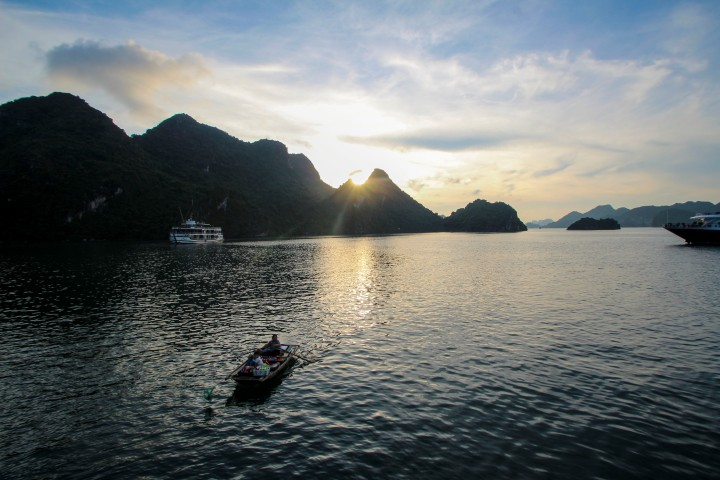 The supermarket boat paddles its way around Ha Long Bay, Vietnam