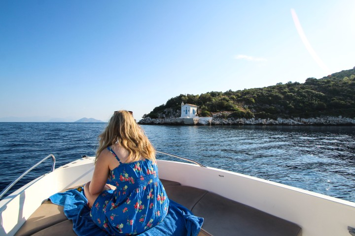 Nicola in a boat by a church, Ithaca, Greece