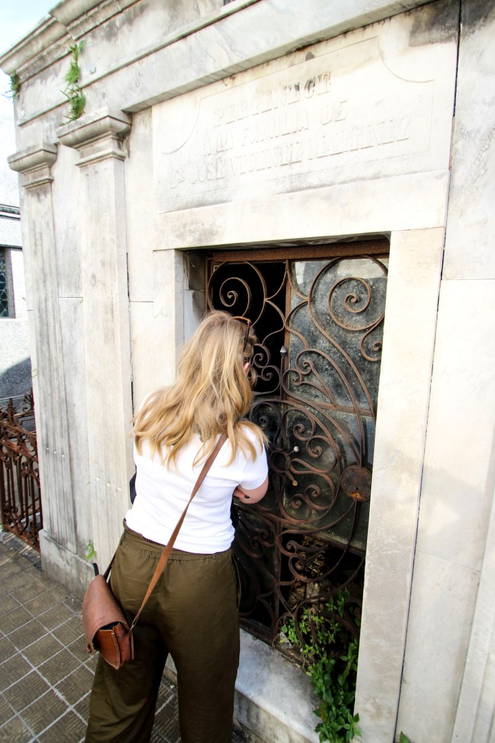 Looking in a grave at La Recoleta Cemetery, Buenos Aires, Argentina